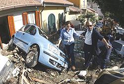 ITALY-WEATHER-RAIN-STREET