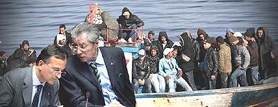 migranti Bossi e Frattini
