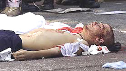 Il corpo senza vita di Carlo Giuliani