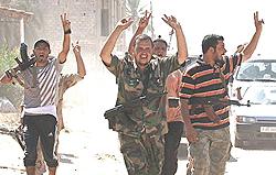 miliziani alla periferia di Tripoli