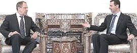 Il ministro degli esteri russo Lavrov col presidente Assad